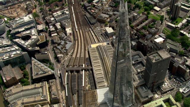 railway tracks visible on ground below the shard - shard london bridge stock videos & royalty-free footage