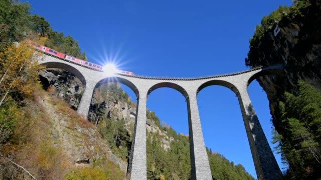 Railway viaduct with train, Landwasserviadukt, Rhätische Bahn, Filisur, Grisons, Switzerland, European Alps