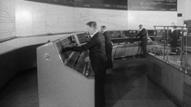 1965 montage railway workers checking signals on monitors in control room, employee attending to outdated signal boxes, with dr. beeching narrating / united kingdom - 1965 stock videos & royalty-free footage