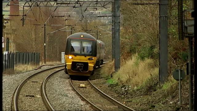 government announces efficiency savings location unknown train along track and past - ファイサル・イスラム点の映像素材/bロール