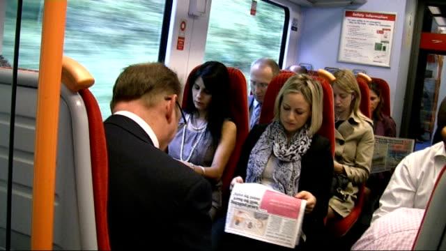 government announces efficiency savings t16081144 england surrey passengers standing on crowded commuter train passengers sitting on train ext train... - ファイサル・イスラム点の映像素材/bロール