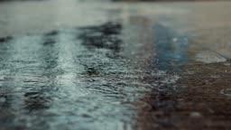 Rain and ripple on concrete floor