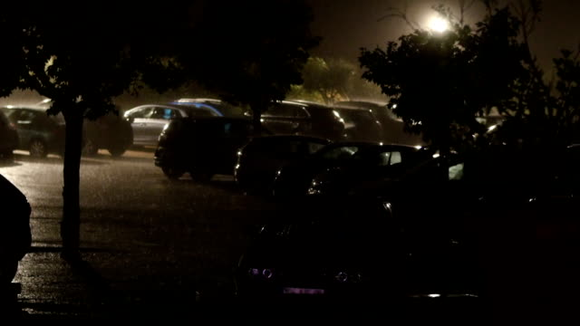 rain and storm on a parking during night. - horror stock videos & royalty-free footage