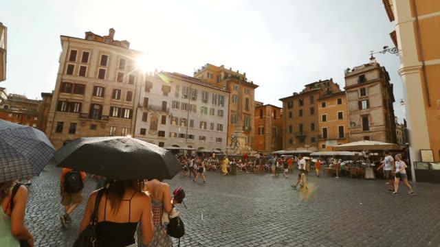 rain and sun on tourists at piazza della rotonda - courtyard stock videos & royalty-free footage