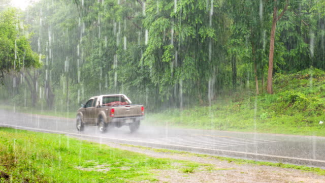 Rain and traffic on a countryside road, Time lapse video