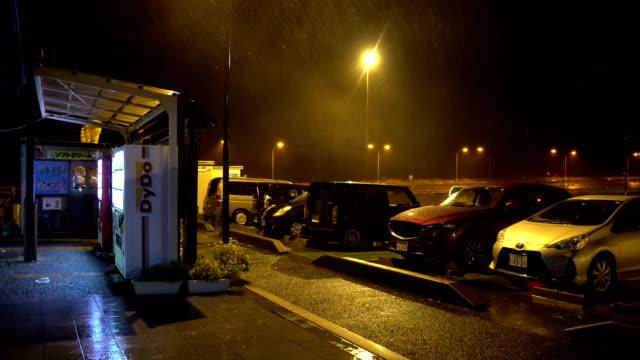 rain and wind swirl through a parking lot at night as typhoon jongdari hits japan - hamamatsu stock videos and b-roll footage