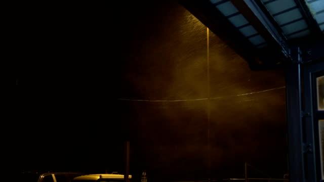 rain and wind swirl through street lights at night as typhoon jongdari hits japan - hamamatsu stock videos and b-roll footage