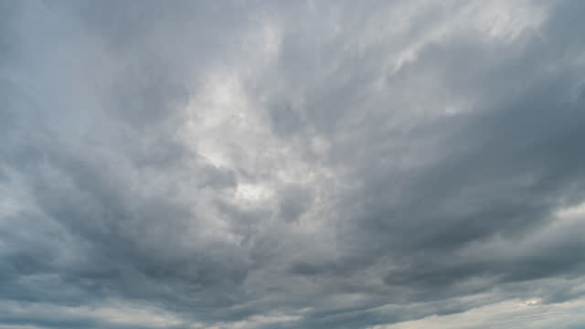 rain clouds and sky moving 4k time lapse. - extreme weather stock videos & royalty-free footage