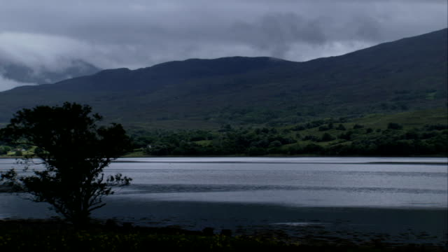 rain clouds loom above scottish hills. available in hd. - hill stock videos & royalty-free footage