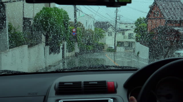 rain drive at residential street - driveway stock videos & royalty-free footage