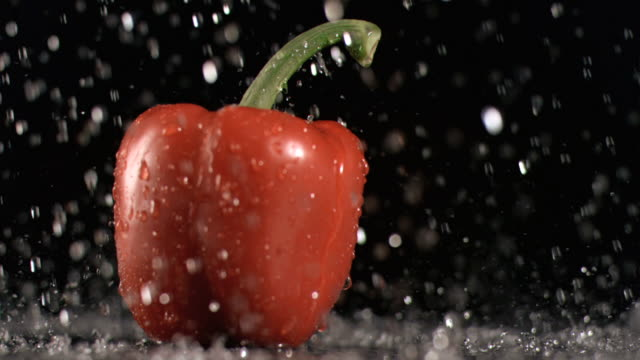 Rain dropping on a pepper in super slow motion