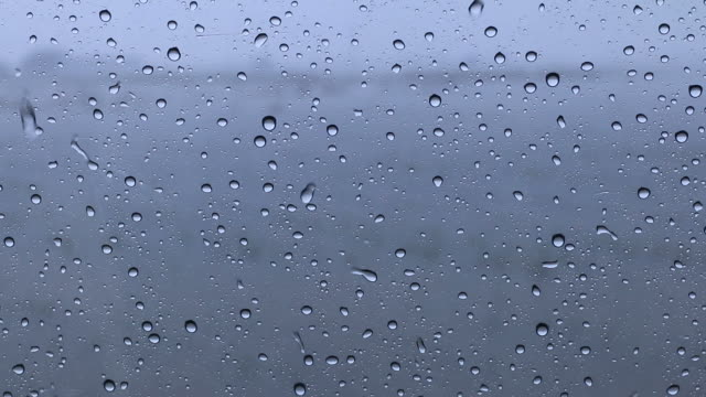 rain drops on car window glass. - splashing droplet stock videos and b-roll footage