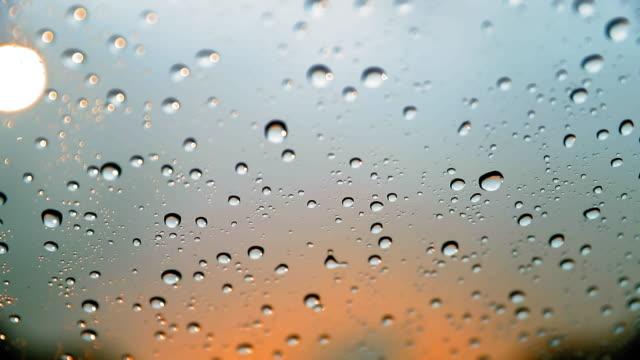 rain drops on the car windscreen - dubai - rain stock videos and b-roll footage
