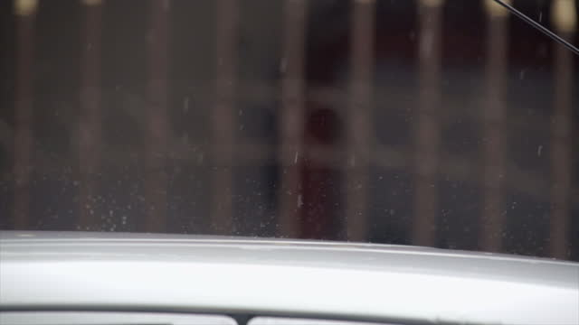 rain fall on car roof slow motion - volume fluid capacity stock videos & royalty-free footage