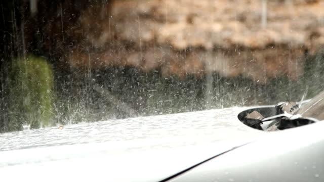 Rain falling on car
