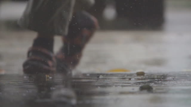 slo mo rain falling on pavement. - wet stock videos & royalty-free footage