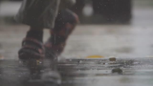 slo mo rain falling on pavement. - wet stock videos & royalty-free footage