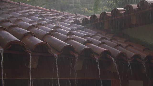 cu pan rain falling on red-tiled roof / santa barbara, california - santa barbara california stock videos & royalty-free footage
