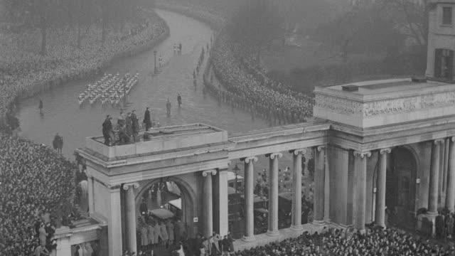 rain falls on a huge crowd that gathers for the funeral procession of king george v in london. - mourning stock videos & royalty-free footage