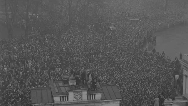 rain falls on a massive crowd gathered for the funeral procession of king george v in london. - british royalty stock videos & royalty-free footage
