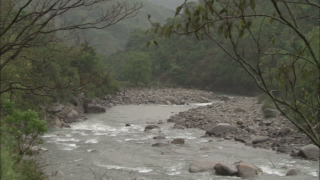 rain falls on river, chopta, india available in hd. - monsoon stock videos and b-roll footage