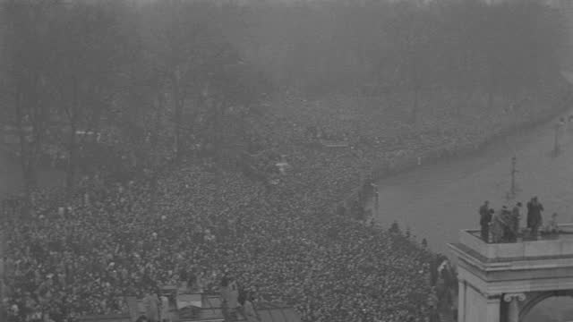 rain falls on the funeral procession of king george v as it passes massive crowds in london. - british royalty stock videos & royalty-free footage