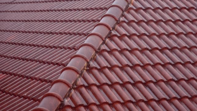 rain falls on the red roof of the house on a day. - roof tile stock videos & royalty-free footage