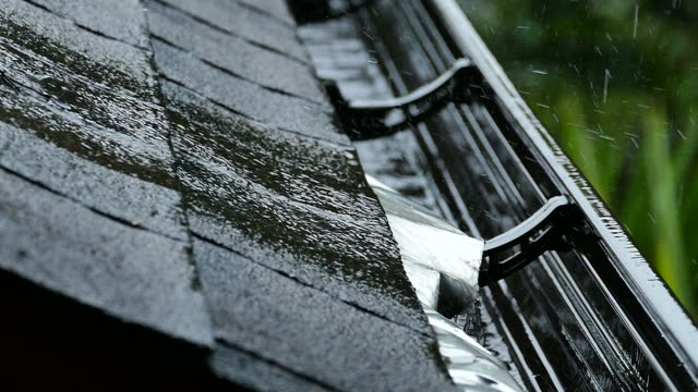 rain gutter storm roof shingles - roof stock videos & royalty-free footage