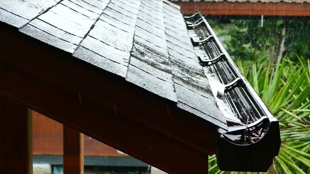 rain gutter storm roof shingles - gutter stock videos and b-roll footage