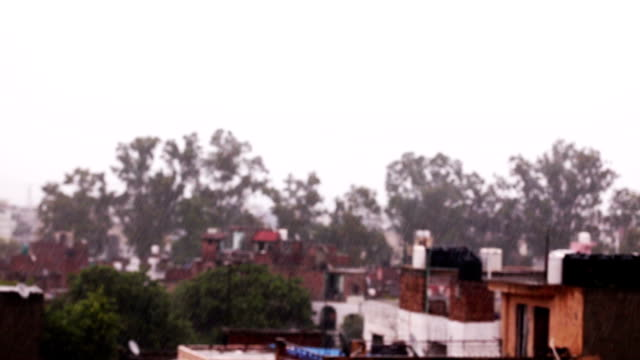 rain in residential area - shower videos stock videos & royalty-free footage