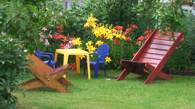rain in the garden - chair stock videos & royalty-free footage