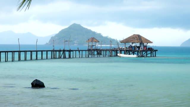 rain in the sea bridge in koh mak, province trat in thailand. - trat province stock videos and b-roll footage