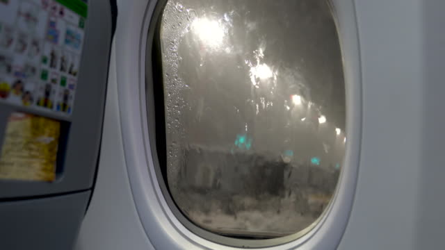 rain is pouring on the window of the airplane - life jacket stock videos & royalty-free footage