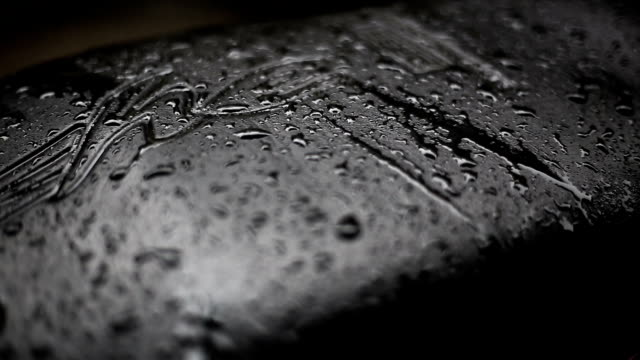 rain on leather seat cover - surface level stock videos & royalty-free footage
