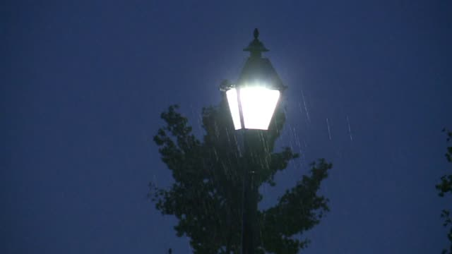 rain on light post at night - indiana stock videos & royalty-free footage