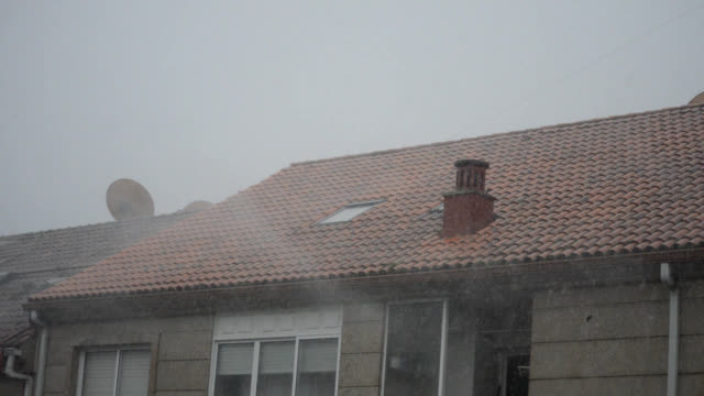 rain pelting on the roof