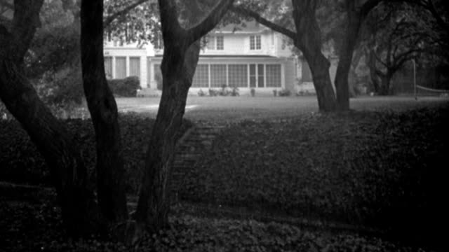 rain pours down on the extensive grounds of a country house. - 1947 stock videos & royalty-free footage