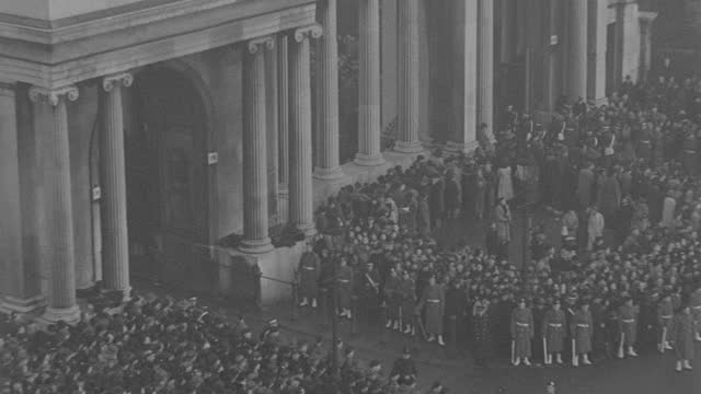 rain pours on the funeral procession of king george v and massive crowds in london. - british royalty stock videos & royalty-free footage