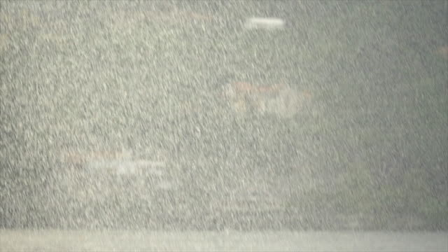 Rain raining hard downpour on a stormy day on Lake Como, Italy, Europe. - Slow Motion