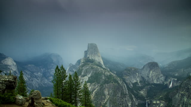 rain storm covering yosemite valley - time lapse - californian sierra nevada stock videos and b-roll footage