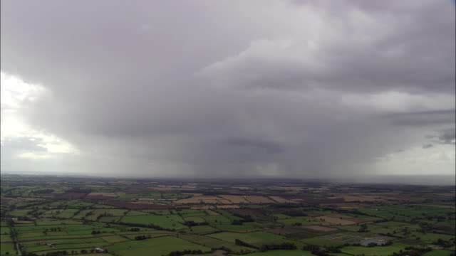 rain storm near melton mowbray  - aerial view - england, leicestershire, melton district, united kingdom - leicestershire stock videos & royalty-free footage