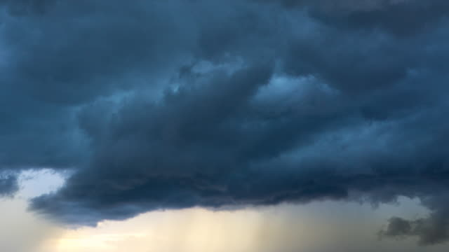 rain strom in sun set - power in nature stock videos & royalty-free footage