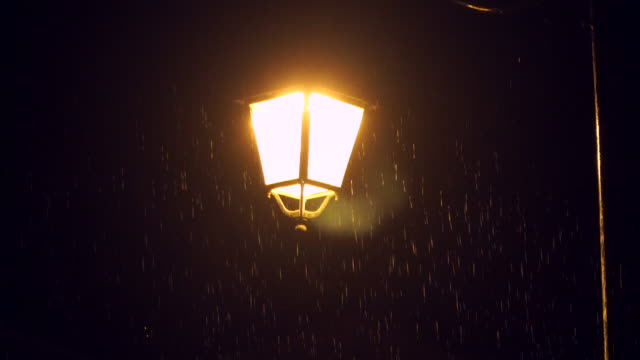 rain under the light of the lantern - electric lamp stock videos & royalty-free footage