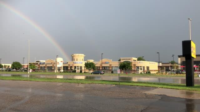 Rainbow and traffic in Fargo, North Dakota, USA