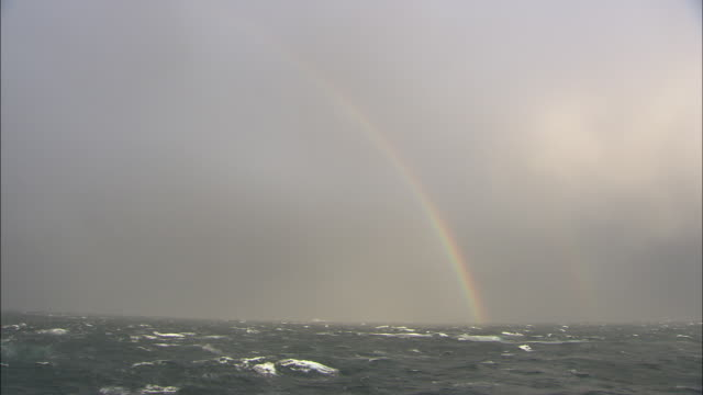 a rainbow arcs over the norwegian sea.  - norwegian sea stock videos & royalty-free footage