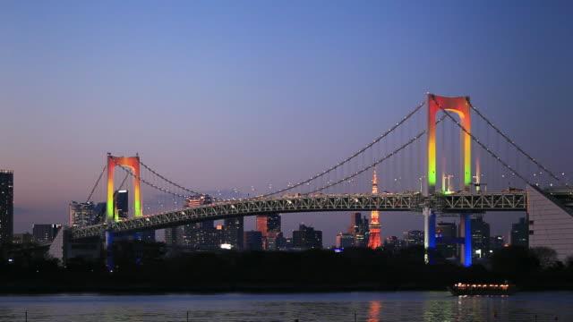WS Rainbow Bridge at dusk, skyline with Tokyo Tower in background / Minato, Tokyo, Japan