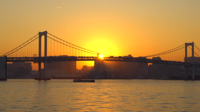 rainbow bridge at dusk, tokyo, japan -boat - tokyo bay stock videos and b-roll footage
