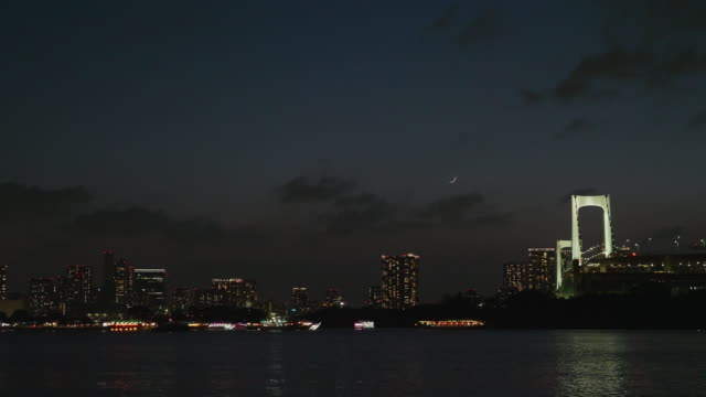 rainbow bridge light up at night - tokyo bay stock videos and b-roll footage