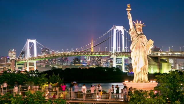Rainbow Bridge Viewpoint And Replica Statue Of Liberty At Night