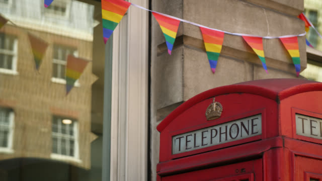 rainbow bunting above red telephone box - identity stock videos & royalty-free footage